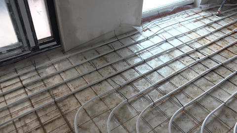 Underfloor heating system pipes on the floor. Floor heating manifold place Live Action