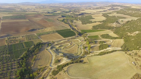 Aerial footage of planted fields and agriculture and beautiful nature and landscape. Countryside Live Action
