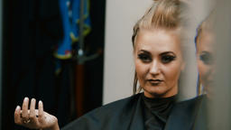 Hairdresser makes hairstyle girl Footage