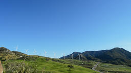 Wind turbines energy tower in the mountain with blue sky Footage