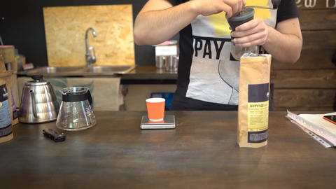Barista Tamping The Grind Coffee For Chemex Footage
