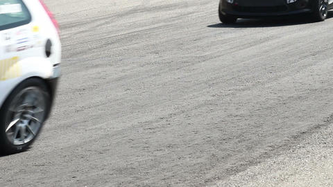 Racing track tarmac cars pass by Footage