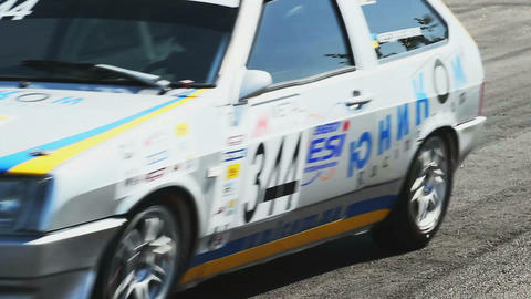 Racing cars pass the racing track tarmac with roaring sound Footage