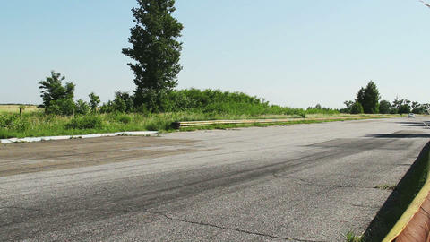 Sport car passes by closely during race laps in competition at daytime Footage