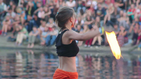 Young female twisting and spinning chained fire pois Footage