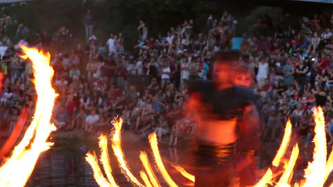 Timelapse of fire show performance by three flame artists, pois chains Footage