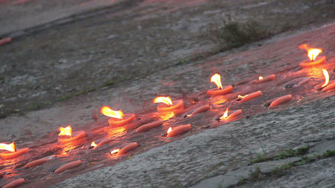 Burning memorial candles on concrete. Memory, mourning day Footage