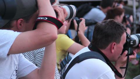 Photographers taking long range photos of event Footage