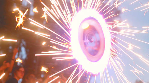 Spinning firework wheel, sparkles all around, fire show performance Footage