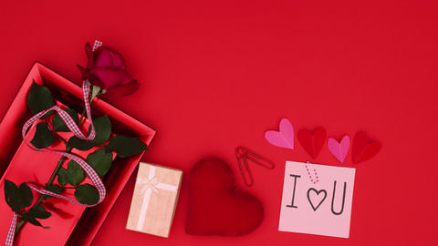 Valentine's day decoration on red background. Paper with I love you text and red and pink hearts Animation