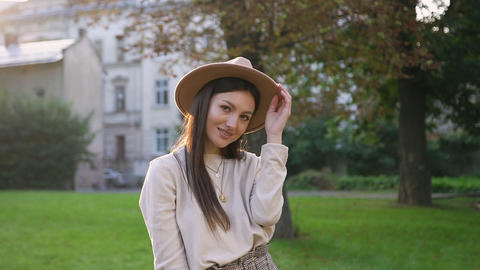 Gorgeous carefree happy woman in trendy hat looking at camera with sincerely Live Action