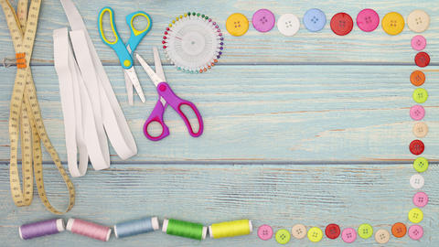 Stop motion animation of beautiful frame made of sewing materials, scissors, buttons, pins, elastic Animation
