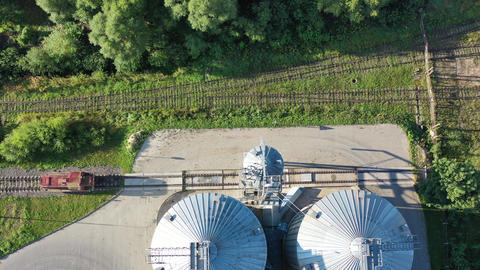industrial grain silos grain storage and old railroad railway from drone, aerial view Live Action