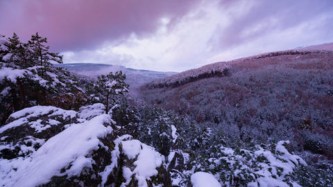 Sunset time lapse of snowy landscape. Sunset view time lapse of snowy mountain Live Action