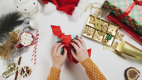 Top View Woman Unwrapping Christmas Present Live Action