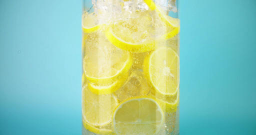 Pouring cold homemade lemonade into a glass, close-up slow motion shot on Red Live Action