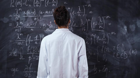 Female student think about equation on board. Solve and prove the theorem Live Action