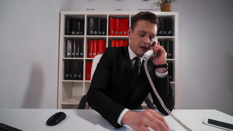 Handsome businessman ask You wait and precise some Your questions by telephone Live Action