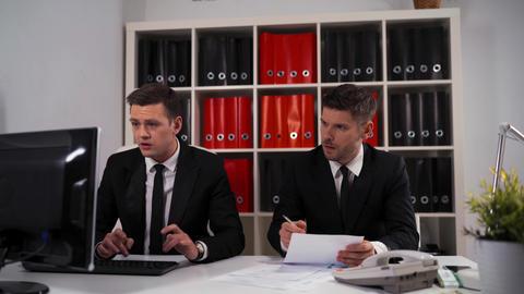 Businessman peek to his collegue eployee desktop computer Live Action