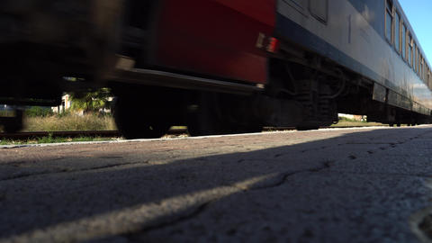 Running train view from below. A train pulls up to a platform slowing down Live Action
