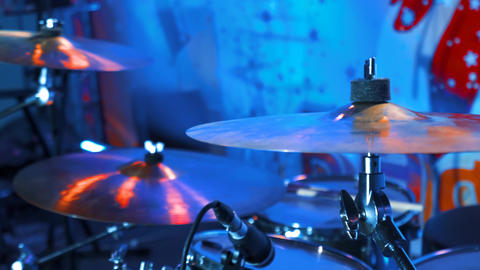 4k UHD Drum kit on stage with soffits and light equipment. Drum-plates close-up Live Action