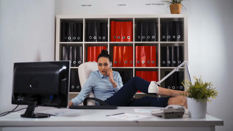 Relaxed businesswoman satisfied in office Live Action