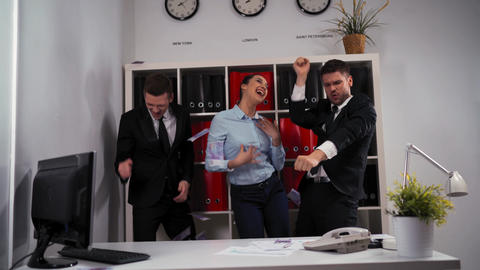 business concept - happy business team celebrating victory and dance in office Live Action