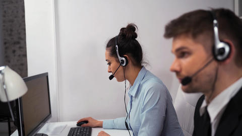 Customer service team taking calls in busy call centre Live Action