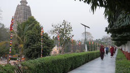 Pilgrims and monks walking around temple,BodhGaya,Mahabodhi Temple,India Footage