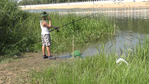 Boy catches fish Footage