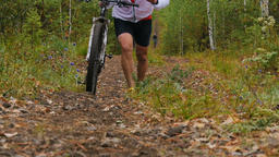 male athlete a cyclist climbs uphill Footage