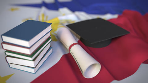 Graduation cap, books and diploma on the flag. Higher education in the Live Action