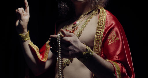 Portrait of an indian deity Surya, the God of sun, holding pearl beads, 4k Live Action