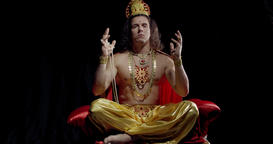 Surya the God of the sun is sitting in lotus position and spreading his arms, 4k Live Action