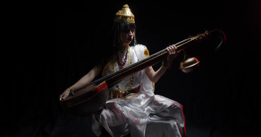 Ancient indian goddess of knowledge is holding the Saraswati veena, 4k Live Action