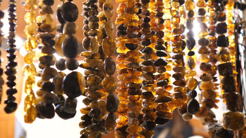Articles made of amber close up.Women's beads. Women's necklaces. Women's Live Action