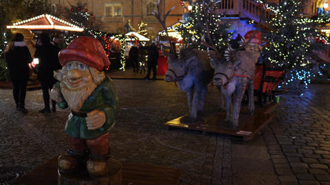 Christmas market at night time in Europe. Christmas tree in background with Live Action
