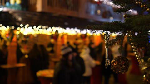 Golden key, Christmas market at night time in Europe. Blured people in Live Action