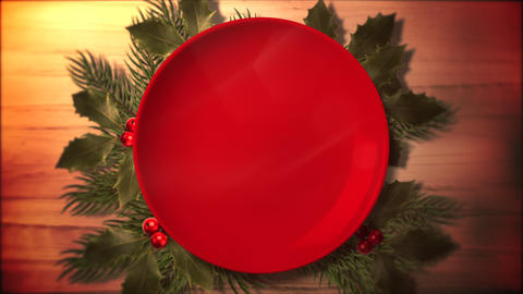 Animated closeup Christmas green tree branches and plate for candy on wood background Animation