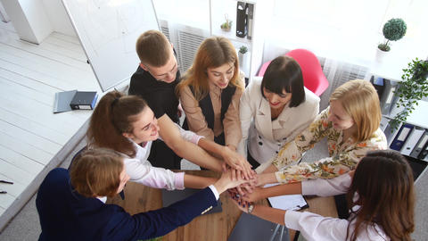 A successful young startup team rejoices at the start of a new project. Hands to Live Action