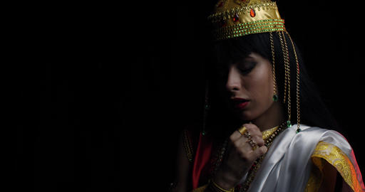 Close up of Saraswati the goddess of knowledge, wearing golden crown, 4k Live Action