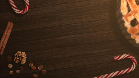 Animated closeup candy and Christmas pie on wood background Animation