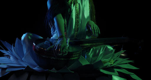 Saraswati in white dress is lying down on her veena, dark green lighting, 4k Live Action