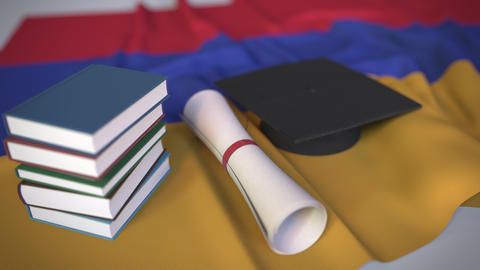 Graduation cap, books and diploma on the Armenian flag. Higher education in Live Action