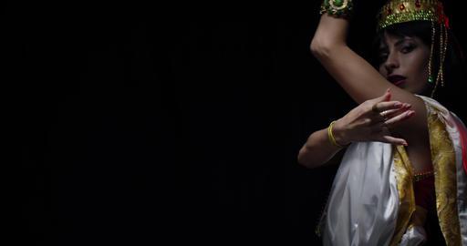 Dancing goddess Saraswati in white dress with jewelry, black background, 4k Live Action