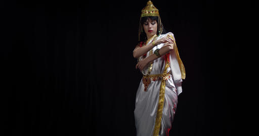 Indian deity Saraswati in white dress, with golden crown on her head, dancing 4k Live Action