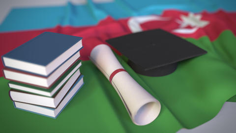 Graduation cap, books and diploma on the Azerbaijani flag. Higher education in Live Action