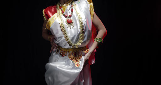 Indian deity Saraswati in white dress is looking and reaching out, 4k Live Action