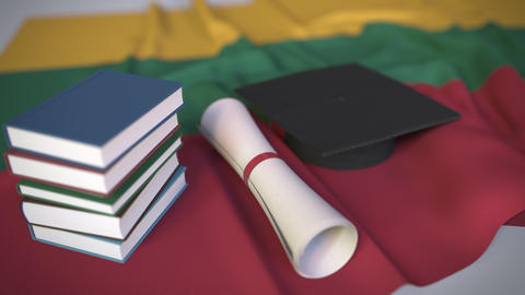 Graduation cap, books and diploma on the Lithuanian flag. Higher education in Live Action