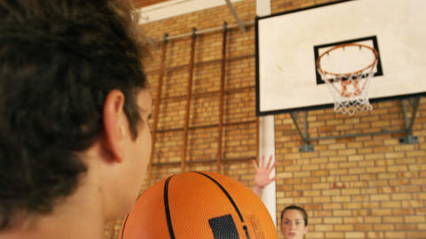 Determined high school kids playing basketball Live Action
